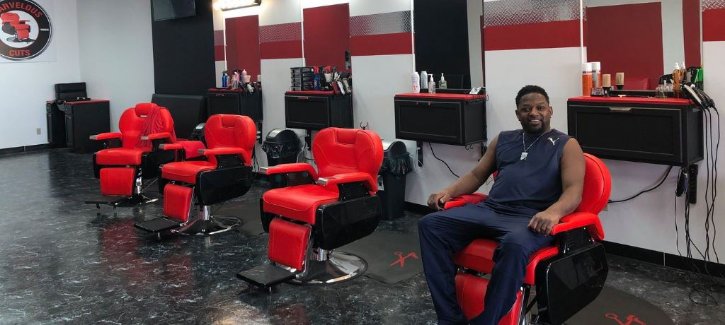 Man in a red chair in a barbershop