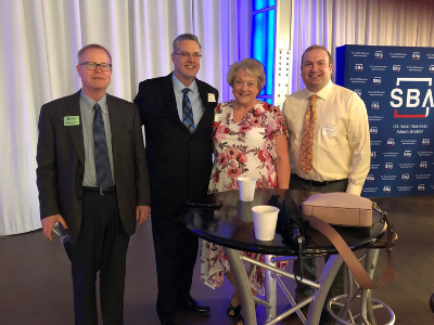 Four business people at an SBA presentation