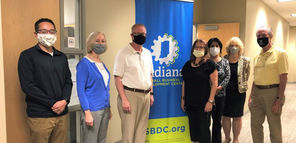 People with covid masks in front of SBDC